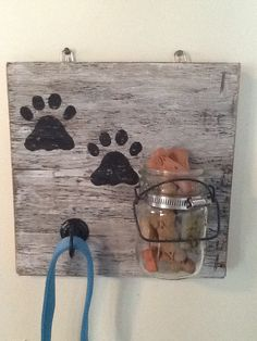I made this from old barn board, vintage mason jars and hand painted dog prints. Made then for Christmas presents and am now selling them!