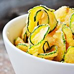 Cut zucchini into 1/4-inch slices (on a diagonal if they're small). Brush both sides with extra-virgin olive