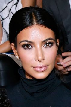 I LOVE KIM KARDASHIAN and I really love how her eyelashes always look A-MAZING!!!! I need to learn how to get this look for my next show!!!!