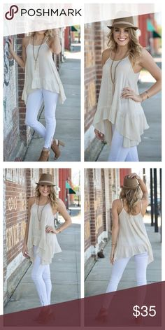 """Just InCrochet Lace Asymmetrical Tunic A Sheer, lightweight,  beautiful piece for spring and summer. Bone colored with lace detail. This tunic swings freely with this Asymmetrical design also giving balance and showing some curves. 65% Cotton 35% Polyester. Bust S16"""" M17"""" L18"""" Length S25"""" M26"""" L27"""" photos courtesy of Infinity Raine. Infinity Raine Tops"""