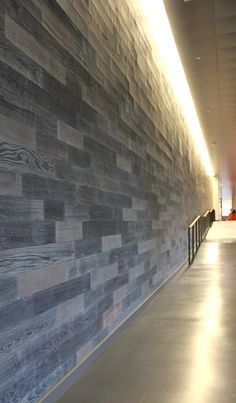 8ce9d7434fc4f Reclaimed Naked Teak Paneling with four different finishes at Amazon s  Block 45 building in Seattle Reclaimed