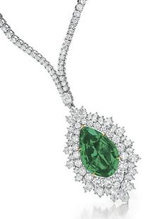 Emerald and diamond necklace, Harry Winston.  Suspending a detachable pendant set with a pear-shaped emerald, weighing approximately 30.19 carats, within a circular and pear-shaped diamond surround, to the graduated circular-cut diamond neckchain, mounted in platinum and gold, 14 ins.