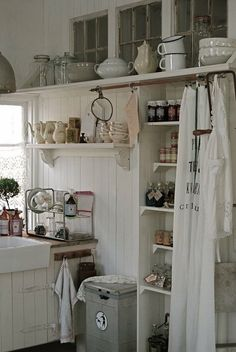Whitewashed Kitchen Cabinets.   Pantry hidden.