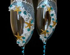 "hand decorated champagne wedding glasses "" Starfish in the wave"". $57.99, via Etsy."