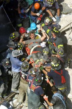 NEW YORK - SEPTEMBER 13, 2001:  A rescue worker is pulled from the rubble of the World Trade Center two days after two hijacked airplanes slammed into the twin towers, levelling them and killing nearly 3,000 people, September 13, 2001 in New York City. This September 11 marks ten years since members of Al Qaeda hijacked four planes, attacking the World Trade Center and the Pentagon and crashing one in Shanksville, Pennsylvania, killing nearly 3,000 people in all. The effects continue to…