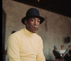 Bill Cosby enjoying a cigar, circa 1960s. According to Cigar Aficianado magazine, his favorite cigar is an Ashton Maduro No. 60.