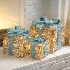 Light up a dark, snowy night with our set of Pre-Lit Iced Turquoise Gift Boxes. Turquoise and gold hues make these a beautiful addition to any fireplace or under your Christmas tree with the rest of the goodies!