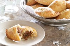 Tourtiere Mini Turnovers - In the old days, cooks baked their pie in a pottery casserole called a tourte. Over the years, the traditional dish changed to a deep-dish pie plate, but the original name stuck. For these turnovers, we skip the dish altogether! La Tourtiere, Escapade Gourmande, Appetizer Recipes, Appetizers, Cream Cheese Pastry, Turnover Recipes, Brunch, What To Cook, Finger Foods