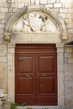 Door, Trogir, Croatia. There are many buildings that have the coat of arms of families that lived there.