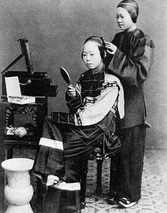 Chinese women - A young woman having her hair done -    Chinese women's clothing naturally varied by class, season, and region of the country, much as men's did, but dresses, skirts, jackets, trousers, and leggings were all common types of garments.