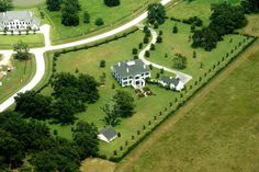 An aerial view of the six-acre property reveals the exceptional grounds and meticulously planned structures and landscaping. Note long winding driveway and graceful approach.