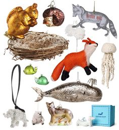 Oh how I love ornaments. The hedgehog! The whale!!! The paper fox, though, is the BEST -- especially when you have cats... via designsponge.