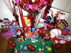 Valentines day gift for him ... Mini liquor bottles, favorite candy, condom roses, lottery tickets ... Stick in foam board