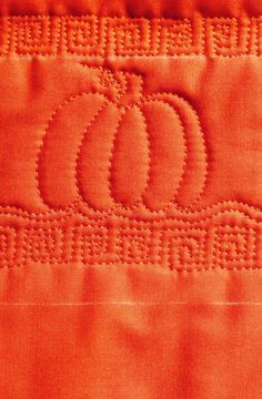 Learn how to stitch the most popular orange squash and make this Pumpkin Free Motion Quilt for fall.