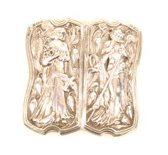 A fine lady's silver waist buckle in the style of William Morris, each half pierced and cast with a female figure one holding flowers the other a crook, amid leaf scrolls, flowers and birds within a shaped frame, Birmingham 1901, by Horton and Allday