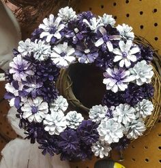 This unique pine cone wreath in shades of blue, gray, pink and white would make a lovely house-warming gift or brighten up your own home. Each pine cone is hand Pine Cone Art, Pine Cone Crafts, Pine Cones, Christmas Wreaths, Christmas Crafts, Christmas Decorations, Pine Cone Flower Wreath, Painted Pinecones, Acorn Crafts
