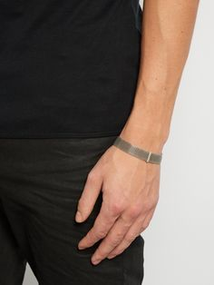 A Title of Work bracelet will bestow your looks with a subtly edgy sensibility. This new-season style is handcrafted from oxidised sterling mesh, so has a cool, rugged finish, and is accented with a solid bar and a hook-clasp fastening.