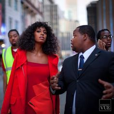 Solange in Red... Follow us @streetvues | streetvue.co  #newyork #streetstyle #streetphotography #style #fashion #primeshot #photographer #solange #red #reddress #redcoat #overtheshoulder #geometric #curls