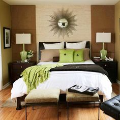 neutral, low contrast colors for walls, draperies, bedding = bedroom looks bigger, as do lg scale accessories. suede covered panels on each side of bed draw eye up