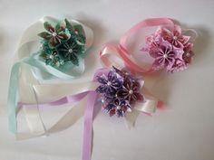 Pastel wedding colours alternative wedding ideas corsage wrist ties paper origami flowers www.lilybellekeepsakes.com
