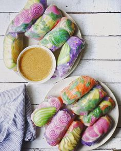 "letscookvegan: "" Psychedelic Salad Rolls by @erinireland 💖 Recipe: Ingredients Serves: 4 For the filling: 8 rice paper wraps 1 head purple cabbage 5 big carrots 1-2 avocados 1 candycane beet 1 watermelon radish For the sauce: ½ c. almond butter 6..."