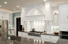 White is not reasonable for a kitchen that you plan to cook in, but can you imagine this beautiful piece in heart cypress? WOW!  Love the smaller keeping cabinets that rest on the countertop.  I would have to have a scene painted in the archway, something French country.  Can you see it?