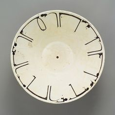 Bowl with Arabic Inscription, 10th century, Iran, Nishapur. Earthenware; white slip with black-slip decoration under transparent glaze. H. 7 in. (17.8 cm). Diam. 18 in. (45.7 cm). Rogers Fund, 1965. Accession Number: 65.106.2 © 2000–2016 The Metropolitan Museum of Art.