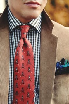 Small print tie, gingham shirt, and plaid pocket square. Fab.