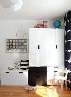 storage solution: Ikea Stuva.There is a ton of storage...decided to use a combination of white doors with a little black.