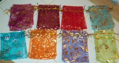 TOTAL OF 50 ORGANZA DRAWSTRING BAGS, ALL COLORS DECORATIVE ONES. 9X12CM, GREAT FOR JEWELRY, CASH, CHANGE, BEADS, JEWELRY FINDINGS AND SUCH. EVERYONE WHO HAS WON THS AUCTION BEFORE HAS BEEN SATISFIED!