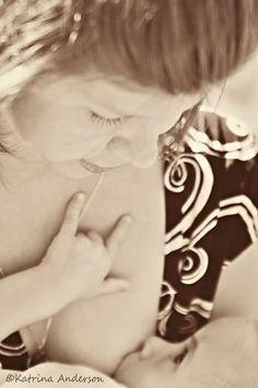 "Breastfeeding baby signing ""i love you"""