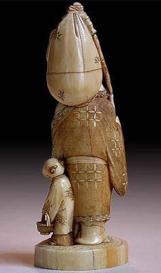 19th Century Japanese Ivory Okimono of Happy Buddha With Boy