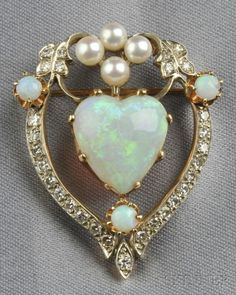 Opal Cultured Pearl and Diamond Pendant\/Brooch set with a heart-shaped opal measuring approx. x x mm single-cut diamond melee accents pearl and opal highlights silver-topped gold mount lg. Opal Jewelry, Heart Jewelry, Turquoise Jewelry, Fine Jewelry, Jewelry Box, Jewellery Rings, Red Jewelry, Luxury Jewelry, Jewelry Stores