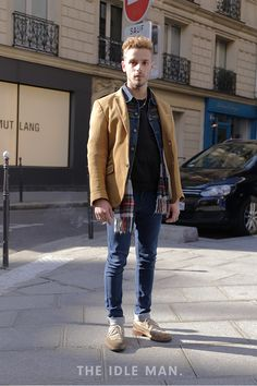 Parisian Chic | To executive this style all you need is skinny denim jeans, a black tee and a denim long-sleeve button up worn open. For some contrast, finish with a tan jacket. | Shop men's clothing at The Idle Man