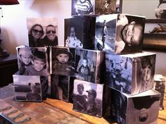 Photo Cubes: I did this for my son's High School graduation party! Styrofoam cubes from the Dollar Tree. Black and white photos cut to size and adhered with stick pins. Use photos from newborn on up...a walk down memory lane!