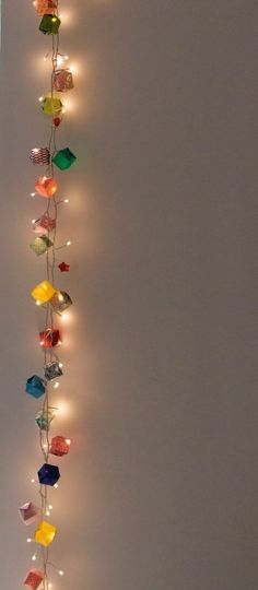 Origami boxes over christmas lights... Amazing for any occasion, but double amazing for a wedding!!