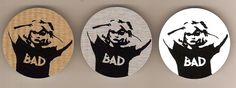 Gold, Silver & White variants of the Andy Warhol's Bad Tee Shirt picture. All 50mm on metal from MF, UK