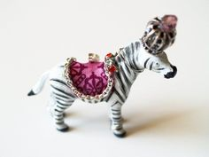 Party Animal Necklace. Love this idea - basically treating a plastic animal like a doll and dressing it. These are for sale but a nifty idea.
