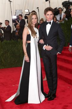 Hannah Bagshawe and Eddie Redmayne wear respectively a Valentino Haute Couture gown from the Fall Winter 14/15 collection and a Valentino tuxedo to attend The Costume Institute Gala 2015 - 'China: Through the Looking Glass' on May 5th 2015