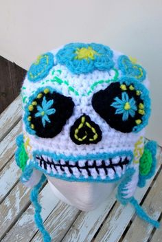 Sugar Skulls are decorated of the Day of the Dead; or, Dia de los Muertos when the souls are able to walk the earth and visit loved ones. This sugar skull hat is made using a soft, white yarn as … Read Crochet Skull Patterns, Halloween Crochet Patterns, Loom Patterns, Crochet Beanie, Crochet Hats, Crochet Clothes, Sugar Skull Costume, Crochet Character Hats, Hat Day