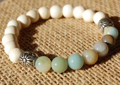8mm mala beads of matte whitewood and Amazonite. Amazonite is used for communication of truth, and integrity. Looks great stacked with other