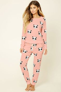 A pair of knit pajama pants featuring a happy panda print and an elasticized waist. Matching tee available.