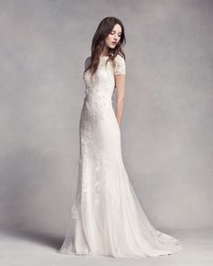 A high neckline can be provocative when paired with an element of surprise such as a plunging back, as seen on the WHITE x Vera Wang Short Sleeve Lace Wedding Dress. Adding a sheer fabric always makes a high neckline look more seductive and flattering on women of all ages. For more expert advice from Vera Wang on this style and other necklines, tap the link in our profile. #WHITExVeraWang #DavidsBridal
