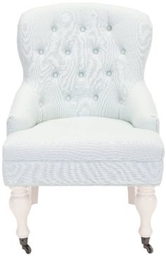 <p>Charming in every designer detail, the petite arm chair recalls richly upholstered parlor and boudoir chairs from a gentler bygone era.  Replete with traditional details, this arm chair is updated with biscuit tufted linen/cotton blend upholstery in robin's egg blue, and features sloped arms. Birch wood spindle legs are finished in ivory and come with front casters for easy mobility.</p>