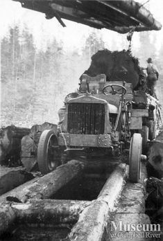 "Loading a White logging truck (unknown year) ""Early White logging truck on a fore-an-aft road being loaded with a hayrack boom. Likely taken in the Port Neville area and part of the Byles and Groves Logging Co. Mel Parker Collection - CR Museum"