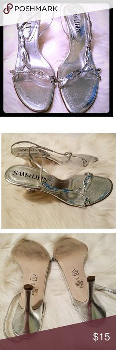 Sam & Libby 9M silver sequin dressy sandals This is a pair of silver sequin heeled sandals by Sam & Libby. The size is 9 medium. Leather upper, manmade sole. Good condition, with flaws shown in photos. Glue showing in a few places, small scuffs on heels, and half a sequin missing (at bottom, and not noticeable when wearing). Sam & Libby Shoes Sandals