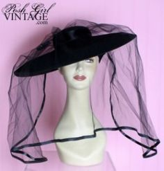 It's a jet black, mint condition all original, vintage funeral mourning hat circa 1940's with original veil, sequined hat pin, rhinestone broach in the back & silk ribbons.