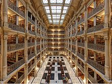 George Peabody Library  is located near John Hopkins. It is one of the largest research libraries.