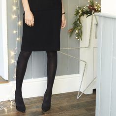 Womens black merino knitted skirt from The White Company - £89 at ClothingByColour.com