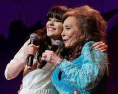 Country music star Loretta Lynn, and singer/actress Zooey Deschanel sing one of Lynn's songs